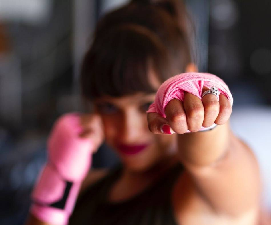 Women fighting with pink gloves, for how do I reduce my risk of cancer post